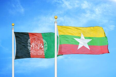 Afghanistan and Myanmar  two flags on flagpoles and blue cloudy sky background 版權商用圖片