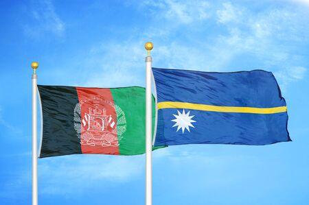Afghanistan and Nauru  two flags on flagpoles and blue cloudy sky background 版權商用圖片