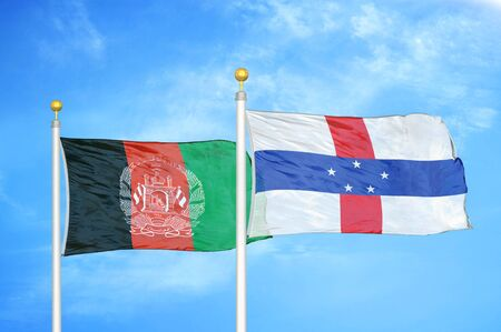 Afghanistan and Netherlands Antilles  two flags on flagpoles and blue cloudy sky background
