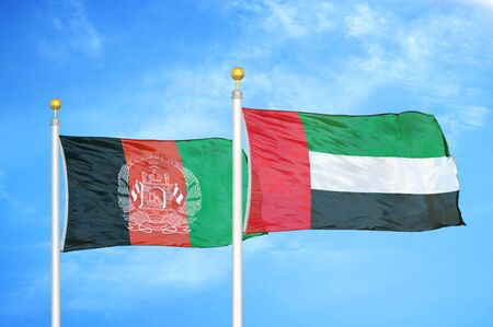 Afghanistan and United Arab Emirates  two flags on flagpoles and blue cloudy sky background 版權商用圖片