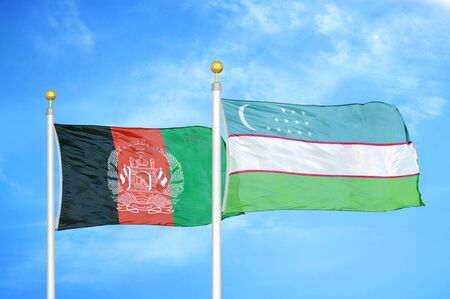Afghanistan and Uzbekistan  two flags on flagpoles and blue cloudy sky background