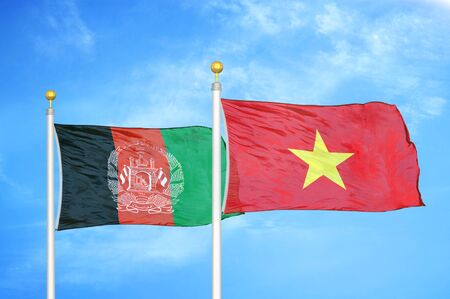Afghanistan and Vietnam  two flags on flagpoles and blue cloudy sky background 版權商用圖片