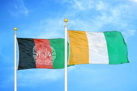 Afghanistan and Cote dIvoire Ivory coast   two flags on flagpoles and blue cloudy sky background