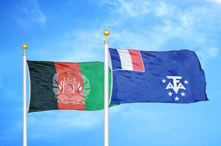 Afghanistan and French Southern and Antarctic Lands  two flags on flagpoles and blue cloudy sky background