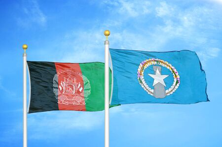 Afghanistan and Northern Mariana Islands  two flags on flagpoles and blue cloudy sky background 版權商用圖片