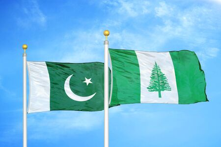 Pakistan and Norfolk Island two flags on flagpoles and blue cloudy sky background