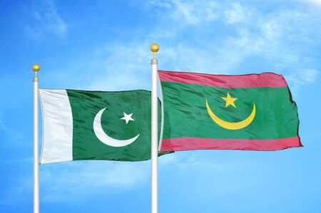 Pakistan and Mauritania two flags on flagpoles and blue cloudy sky background