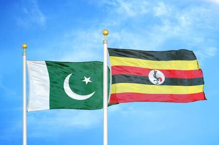 Pakistan and Uganda two flags on flagpoles and blue cloudy sky background 版權商用圖片
