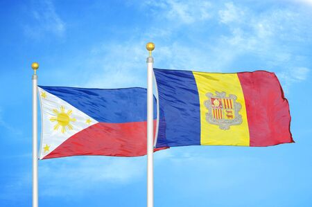 Philippines and Andorra two flags on flagpoles and blue cloudy sky background