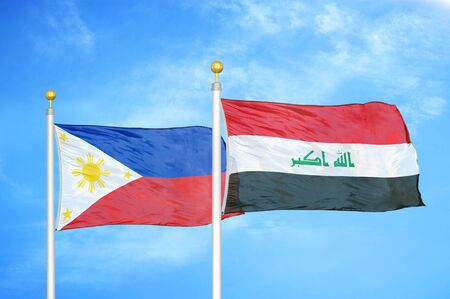 Philippines and Iraq two flags on flagpoles and blue cloudy sky background Reklamní fotografie