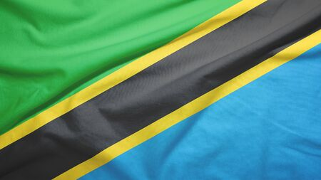 Tanzania waving flag on the fabric texture Standard-Bild
