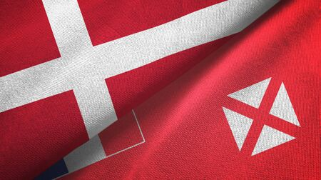 Denmark and Wallis and Futuna two folded flags together