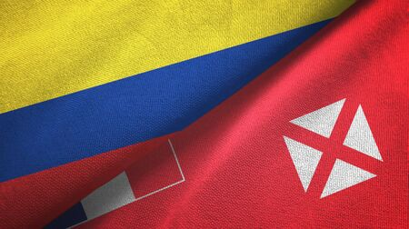 Colombia and Wallis and Futuna two folded flags together