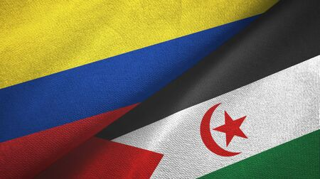 Colombia and Western Sahara two folded flags together