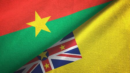 Burkina Faso and Niue two folded flags together