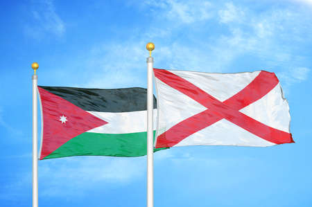 Jordan and Northern Ireland two flags on flagpoles and blue cloudy sky background Stock Photo