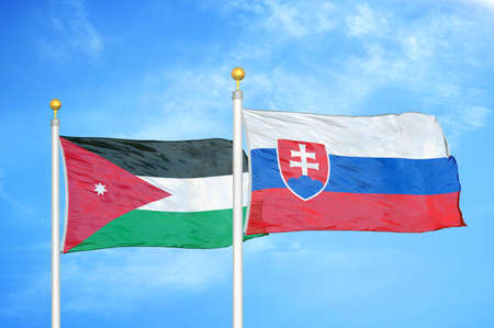 Jordan and Slovakia two flags on flagpoles and blue cloudy sky background