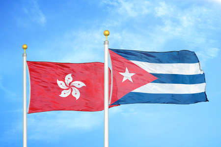 Hong Kong and Cuba two flags on flagpoles and blue cloudy sky background 写真素材