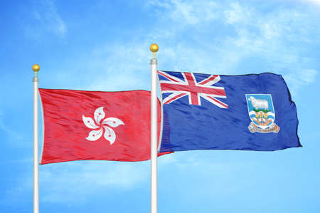 Hong Kong and Falkland Islands two flags on flagpoles and blue cloudy sky background