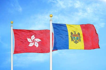 Hong Kong and Moldova two flags on flagpoles and blue cloudy sky background