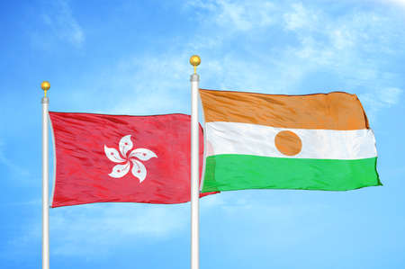 Hong Kong and Niger two flags on flagpoles and blue cloudy sky background
