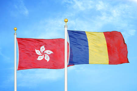 Hong Kong and Romania two flags on flagpoles and blue cloudy sky background