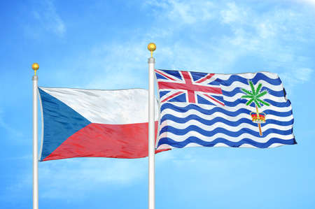 Czech and British Indian Territory two flags on flagpoles and blue cloudy sky background