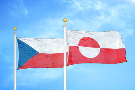Czech and Greenland two flags on flagpoles and blue cloudy sky background