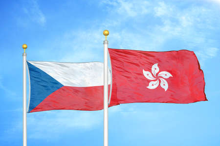 Czech and Hong Kong two flags on flagpoles and blue cloudy sky background