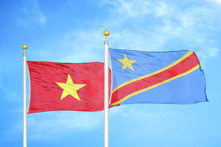 Vietnam and Congo Democratic Republic two flags on flagpoles and blue cloudy sky background