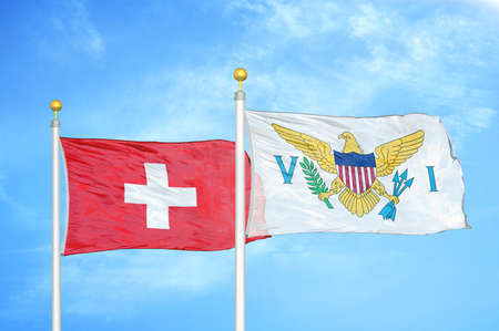 Switzerland and Virgin Islands United States two flags on flagpoles and blue cloudy sky background