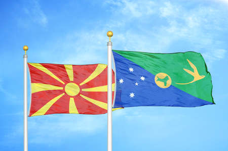 North Macedonia and Christmas Island two flags on flagpoles and blue cloudy sky background Stock Photo