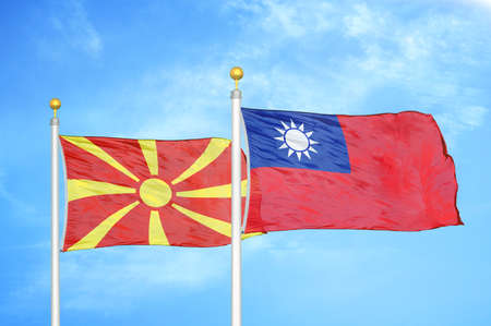 North Macedonia and Taiwan two flags on flagpoles and blue cloudy sky background