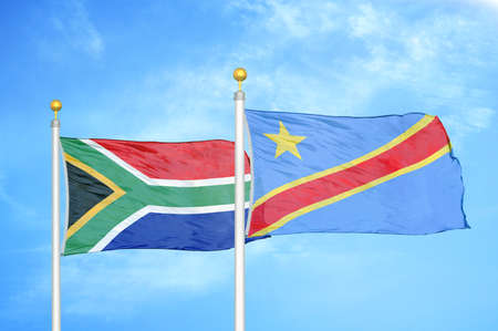 South Africa and Congo Democratic Republic two flags on flagpoles and blue cloudy sky background