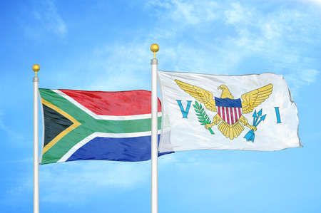 South Africa and Virgin Islands United States two flags on flagpoles and blue cloudy sky background
