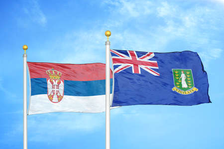 Serbia and Virgin Islands British two flags on flagpoles and blue cloudy sky background