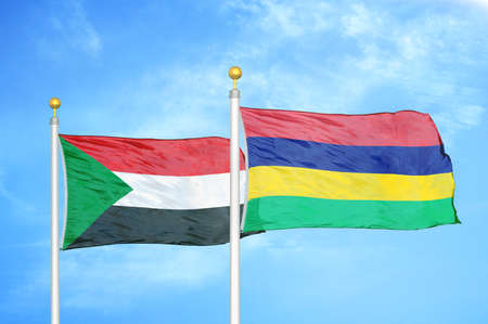 Sudan and Mauritius two flags on flagpoles and blue cloudy sky background
