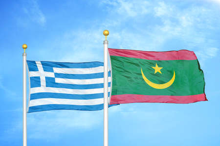 Greece and Mauritania two flags on flagpoles and blue cloudy sky background