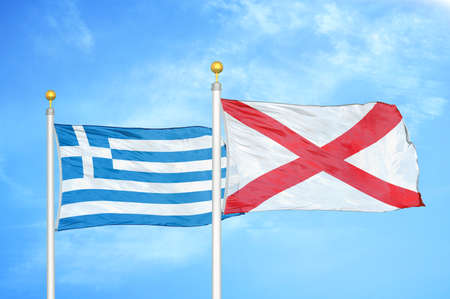 Greece and Northern Ireland two flags on flagpoles and blue cloudy sky background
