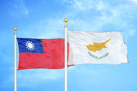 Taiwan and Cyprus two flags on flagpoles and blue cloudy sky background Imagens