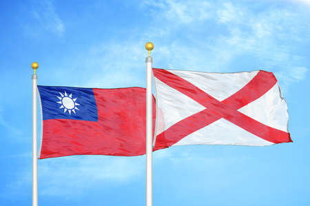 Taiwan and Northern Ireland two flags on flagpoles and blue cloudy sky background