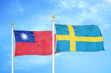 Taiwan and Sweden two flags on flagpoles and blue cloudy sky background