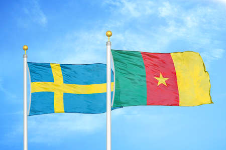 Sweden and Cameroon two flags on flagpoles and blue cloudy sky background