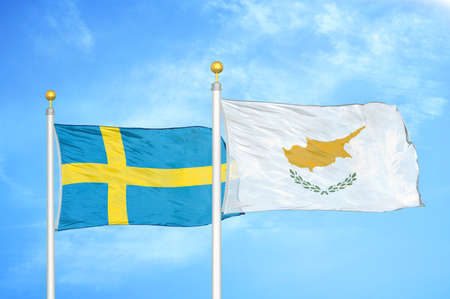 Sweden and Cyprus two flags on flagpoles and blue cloudy sky background