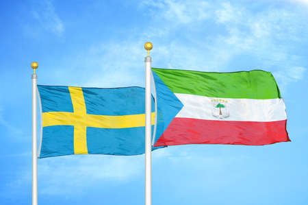 Sweden and Equatorial Guinea two flags on flagpoles and blue cloudy sky background Standard-Bild
