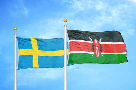 Sweden and Kenya two flags on flagpoles and blue cloudy sky background Standard-Bild