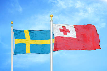 Sweden and Tonga two flags on flagpoles and blue cloudy sky background