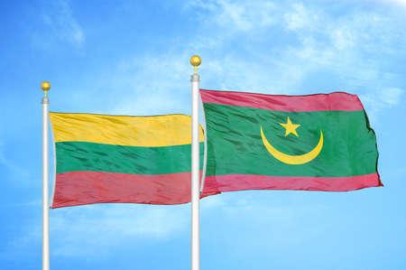 Lithuania and Mauritania two flags on flagpoles and blue cloudy sky background Фото со стока