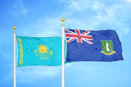 Kazakhstan and Virgin Islands British two flags on flagpoles and blue cloudy sky background