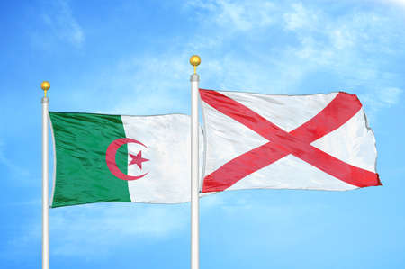 Algeria and Northern Ireland two flags on flagpoles and blue cloudy sky background